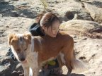 Miss. Park socializing a rescued dog at Heart and Soul Animal Sanctuary